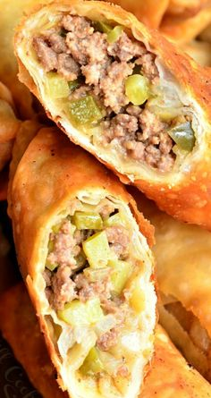 Cheeseburger Egg Rolls ~ Stuffed with juicy ground beef, melted cheese, and pickles.... It's served with a simple sauce on a side.