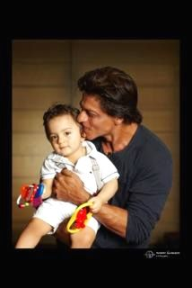 """SRK reveals son AbRam's picture http://www.andhrawishesh.com/telugu-film-movies/movie-news/47342-srk-reveals-son-abrams-picture.html  Bollywood baadshah #ShahRukhKhan who has been hiding his youngest son AbRam's identity for a while, has finally revealed his picture on Monday wishing his fans. """"Eid Al Adha Mubarak to everyone. May all have the happiness that life has to offer. The littlest one wishes you too,"""" tweeted Shah Rukh along with the picture of AbRam."""