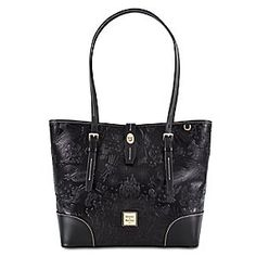 Upon second look, this striking, black leather tote reveals embossed art featuring charatcers and icons from Disney theme parks. Fashionable with plenty of room inside, this bag has all the style and magic you need.