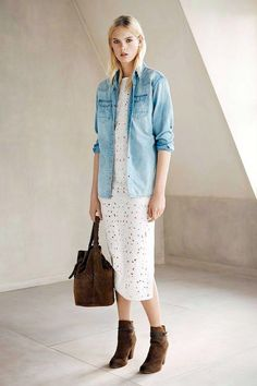d95a9f189b90 Photo via  All Saints This western-inspired spring look is everything!  Loving the denim shirt worn over her white eyelet midi dress.