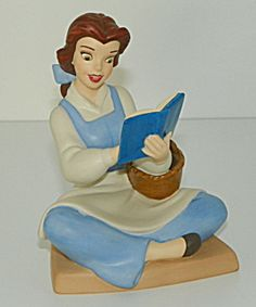 Disney Figurine Titled The WDCC Disney Figurine Beauty and the Beast Belle Bookish Beauty Membership Piece 2005   Character: Belle   Title: Bookish Beauty   Size: 4 inches   Item Number: 4002267   Sculptor: Dusty Horner   Included: Complete Kit Items Original Box, A special tribute to the artistry of 'Beauty and the Beast,' this beautiful produced lithograph is based on art created for Disney Publishing. A fine art print (at left) of the original animation drawing that inspired this year's…