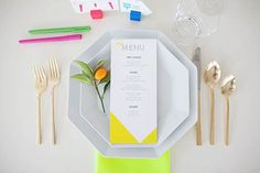 Neon and white geometric wedding place setting.