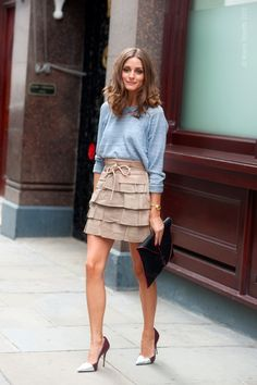 tiered skirt paird back to casual sweatshirt. add pumps and clutch for a dressed up casual look .