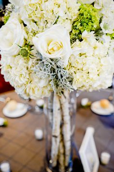 Birch pole centerpiece with white roses, white and green hydrangeas, and dusty miller by Plum Sage Floral #rustic #wedding