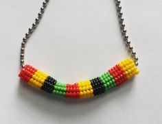 Check out this item in my Etsy shop https://www.etsy.com/listing/208143026/herringbone-ndebele-beaded-tube-necklace