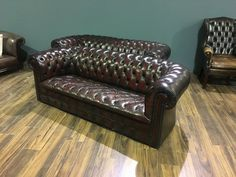 A Very Cool Matching Pair of Vintage Leather Chesterfield Sofas