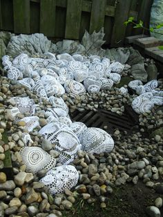 Concrete leaf stepping stones and 70 stones covered in doilies= romantic garden art. By Odile Gova