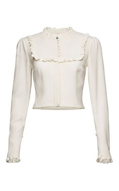 This shirt by **Magda Butrym** is rendered in white silk and features a high neck and frill bib and cuffs.