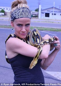 Peterson is seen posing with a snake in the 2012 photoshoot
