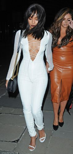 Bright white: The jumpsuit showed off her tiny waist and perfectly proportioned hips...