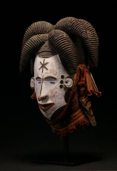 Africa | Maiden Mask from the ibo people of Nigeria | Wood, pigment and textiles | ca. early 20th century