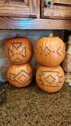 Unique Thanksgiving decor: Navajo style nailhead, studded pumpkins.