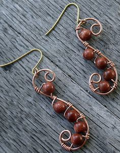 Love the simple, rustic wood background for these earrings. really love the earrings!