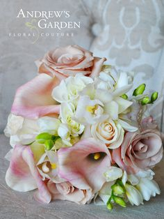Blush colors in Mini Calla Lilies, Mini Cymbidium Orchids, Roses and Freesia.