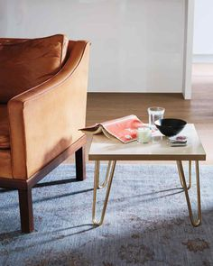 Money-Saving Home DIYs: 12 Things You Should Make Instead of Buy | Martha Stewart Living - This cute little side table is totally customizable, and it only costs about $100 to make! We love the modern-chic brass legs.
