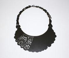 ASHLEY BUCHANAN-USA  Selective Piercing Neckpiece  2012  Hand-cut brass, powder coated charcoal