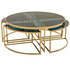 Glass top nesting coffee table with a lavish gold frame with smoked glass finish. Channel contemporary glamour into your interior with the Pavoda Coffee Table The Pavoda has a circular frame with timeless, luxurious appeal, making it the perfect foc Lift Up Coffee Table, Brass Coffee Table, Round Coffee Table, Coffee Table Design, Square Glass Coffee Table, Steel Furniture, Table Furniture, Furniture Design, Gold Furniture
