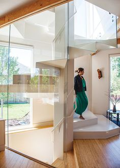 Make a statement with an entryway that forms the central core of a house, like this glass-enclosed spiral.