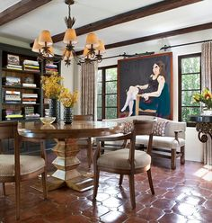 Spanish colonial dining room with sparkling terracotta tiles [Design: Jonathan Winslow Design]