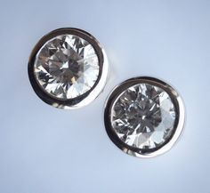 LOT 302: A good pair of diamond single stone ear studs in white gold rub over mount. Approx. 2 carats in total. Est. 2500 - 3000. In our #CHRISTMAS #Silver #Jewellery #Watches #Collectables #Pictures and #Furniture #Auction #December8 #whittonsauctions #Honiton #pin In conjunction with the #BBC who will be filming #BargainHunt