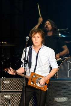 In a surprise guest section of the 2013 Seattle concert, Sir Paul McCartney performs with ex-Nirvana drummer Dave Grohl.