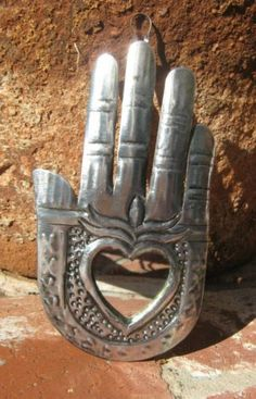 Milagros, originating in Latin America, are signs of gratitude for prayers answered. Memento Mori, Miraculous, Heart Mirror, Metal Embossing, Zen, Tin Art, Heart Hands, Meditation, Hand Of Fatima