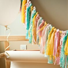 Make your own fabric garland by following this simple scrap fabric garland tutorial. Fabric garlands are great party & kid's room decor.