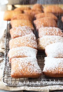 """There's nothing more sweet and iconic in New Orleans' French Quarter like a fresh batch of beignets (""""ben-yays""""). The timeless dessert is a highly recommended staple that both locals and tourists cannot resist. If you love beignets, then here's an authentic recipe from the Big Easy just for you! It's more than 'just' a donut. … Cajun Recipes, Sweet Recipes, Donut Recipes, Cookie Recipes, Bread Recipes, Baking Recipes, Recipe For Beignets, New Orleans Beignets Recipe, French Quarter"""