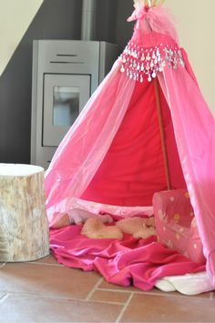 DIY - Pink Teepee @Anna Helgadottir O'Dell... except with red or yellow. looks simple.