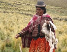 Indigenous Woman of the Bolivian Highlands Spinning Wool - Pixdaus
