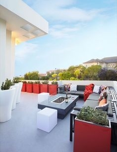 Bright accents stand out in this outdoor seating area with a gorgeous view, completed by Dupuis-Design. #luxeSoCal
