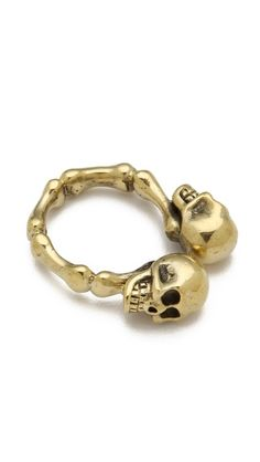 Two skulls enter, one skull leaves...I don't know I had to write something; it's a cool skull ring that's it...