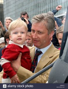 Stock Photo - (dpa) - The Belgian royal family -here Crownprince Philippe with Prince Gabriel - walk through Brussells on the occasion of the National Day on Thursday, 21 July Belgium - Hakim Bonnar 21 July, Gabriel, Royalty, Prince, Walking, 21st, Stock Photos, Couple Photos, Thursday