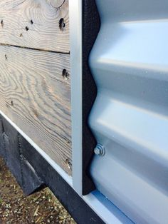 Closeup of foam closure between barn wood siding and metal siding trim of our…