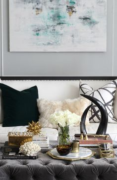 Early Fall home tour 2016 | Sofa pillow styling from Kristin Cadwallader of Bliss at Home | hunter green and emerald green with gold and tortoise glass make a moody fall room | gray tufted velvet ottoman from Taylor Burke Home | Kelly Wearstler Channels pillow from Stuck on Hue | luxe home decor details | abstract art | Fur Alpaca pillow from Frontgate