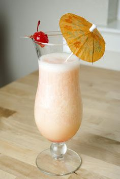 Banana Pineapple Colada - 2 oz coconut rum - 1 oz banana liqueur - 4 oz banana puree - 1 oz pineapple juice splash of grenadine
