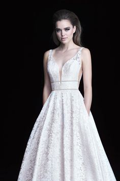 """@palomablancawed   Style 4754, Paloma Lace #WeddingDress. Paloma #Lace gown with plunging neckline bodice with double beaded bands across midriff and waist. V-shaped Italian Tulle inserts at side seams on bodice. Full circle skirt with pockets finished with 4"""" horsehair edging on lace hem. Paloma Blanca wedding dress"""