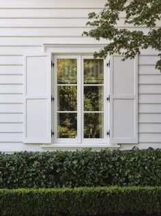 real shutters are the only way to go and this is a good white / a classic white house by andrew skurman.