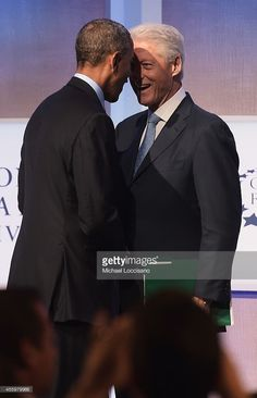 President of the United States Barack Obama shakes hands with Former U.S. President Bill Clinton before closing the 'Cities as Labs of Innovation' Plenary Session during the third day of the Clinton Global Initiative's 10th Annual Meeting at the Sheraton New York Hotel & Towers on September 23, 2014 in New York City. The annual meeting, established in 2005 by President Clinton, convenes global leaders to discuss solutions to world problems.