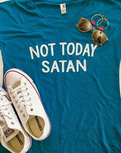 Welcome to Bug&Bee Shop!  Not Today Satan!  This sassy tee is made using professional quality heat transfer vinyl, and is pressed to order on an industrial strength heat press. **DETAILS** This tee is a mixture of 50% polyester, 25% cotton, and 25% rayon. It is a super soft short sleeve, with a relaxed fit. Measurements can be found in album above  **PLEASE INCLUDE DESIRED COLOR FOR VINYL WORDING IN THE NOTES AT YOUR TIME OF PURCHASE** Unless otherwise noted, teal shirts will be made with...