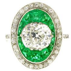 Antique old mine cut diamond and emerald ring