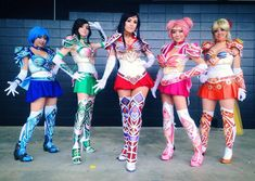 Armored Sailor Scout group Cosplayers from left to right:Gladzy Kei Art & Cosplay , Andy Rae Cosplay Jessica Nigri, Vivid Vision and Pompay's Cosplay Page - Jessica Roh