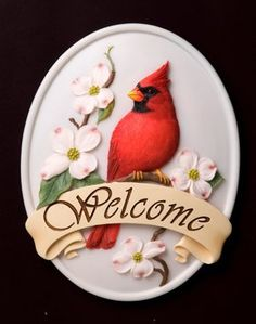 """Cardinal on Dogwood Welcome Sign - Ibis & Orchid Design Collection by Ibis & Orchid Welcome Plaques. $15.29. Hand Painted. Beautifully Sculpted. Exquisite Detail. Durable Bonded Marble. What a lovely addition to greet your family and guests as they come to your home, office, garden or special spot. Ibis & Orchid design has provided a beautifully sculpted """" Welcome Plaque """" with many styles to fit just right with your decor. Bold and dynamic detail on each plaque, hand..."""