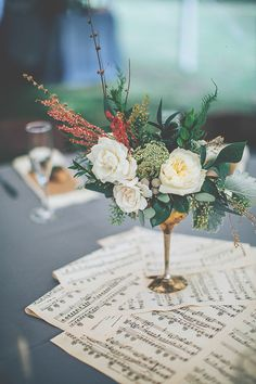 You could use music sheets in your centerpieces if you are a lover of music or play an instrument. Photo by @paperedhrtphoto