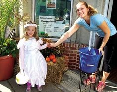 Jen Marra / Isabella Morgan, 5, of Northfield is a bride and visits Amelia Morin at Yoasis for a lollipop.