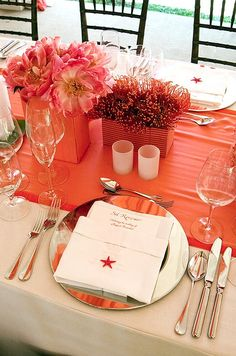 Menus become placecards when printed with guests' names. A small red starfish adds a pop of color to a white napkin.