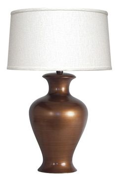 Home staging tip: Copper-colored décor like this Copper Frescalina Table Lamp with a glossy finish can often be used as a bold statement while harmonizing well with large pieces of furniture. || furniture.cort.com