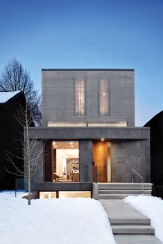 This two-story home in Toronto draws light into its open-concept living space and modern Scandinavian-style kitchen through reflective aluminum louvers.