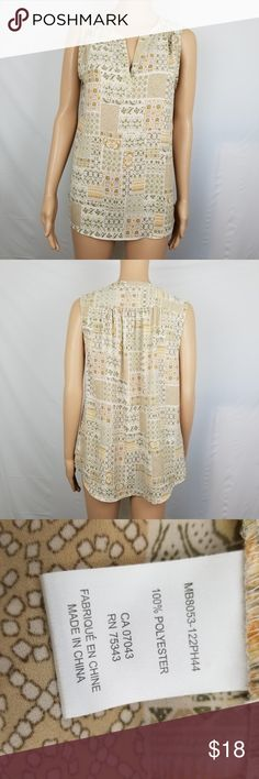 """Saint Tropez West Tunic Top V-Neck Sleeveless M Great Condition!  Please see pictures for additional details.  Measurements (all approximate)  Size: M  Bust: 40"""" (20"""" pit-pit)  Length: 26.5""""  Ship within 24 hours  Please note: All items are cross-posted, if they sell on another platform I will delete the Posh listing. All items are shipped securely packed with love but without added waste like tissue paper or ribbons. Saint Tropez West Tops Tunics"""