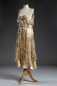 1921 Ivory satin wedding dress, worn by the donor's mother, Annie Kangeter who married Dr. Charles D. Boette, April 14, 1921, at her home in Charleston. Annie's sister, Mamie Pfaehler made the dress.  Via Charleston Museum, flickr.